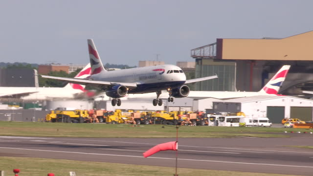 british airways aircraft lands at heathrow airport - heathrow airport stock videos and b-roll footage