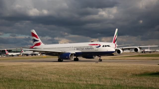 british airways aircraft taxis at heathrow airport on october 11, 2016 in london, england. the uk government has said it will announce a decision on... - air vehicle stock videos & royalty-free footage