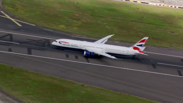 british airways, carrying remaining competitors of team gb from tokyo olympics 2020, lands at heathrow airport - moving down stock videos & royalty-free footage