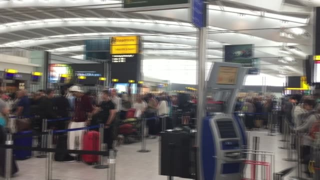 ba chief executive apologises england london heathrow airport int delayed british airways passengers queueing in terminal 5 departures area ba sign... - ヒースロー空港点の映像素材/bロール