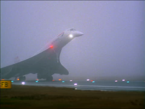 pan british airways concorde jet landing at airport on rainy foggy day - british aerospace concorde stock videos & royalty-free footage