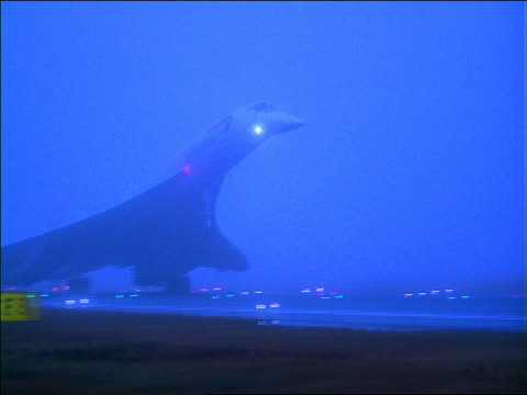 blue pan british airways concorde jet landing at airport on rainy foggy day - supersonic airplane stock videos and b-roll footage