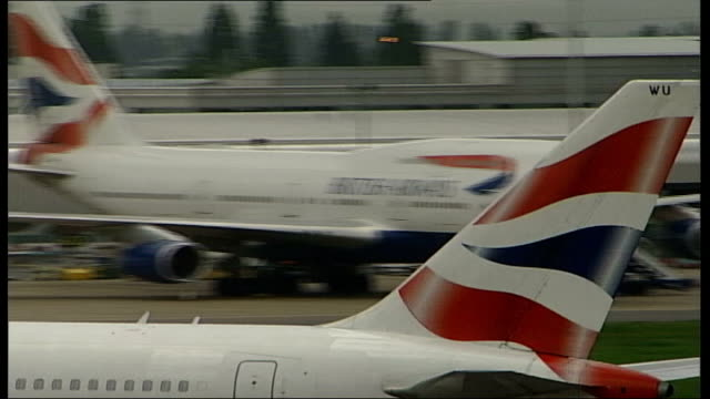 british airways investigated over alleged price fixing file / r18050623 london heathrow airport ext tail fin of ba plane along as taxiing on tarmac - tail fin stock videos & royalty-free footage