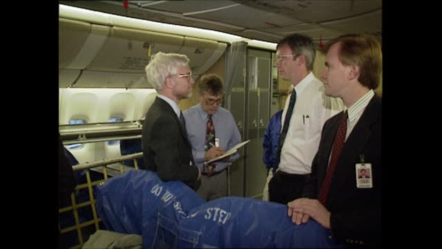 stockvideo's en b-roll-footage met boeing 777 usa seattle int carpet being laid inside new boeing 777 plane tgvs hangar and planes more shots hangar and planes sign boeing 777 on steps... - new not politics