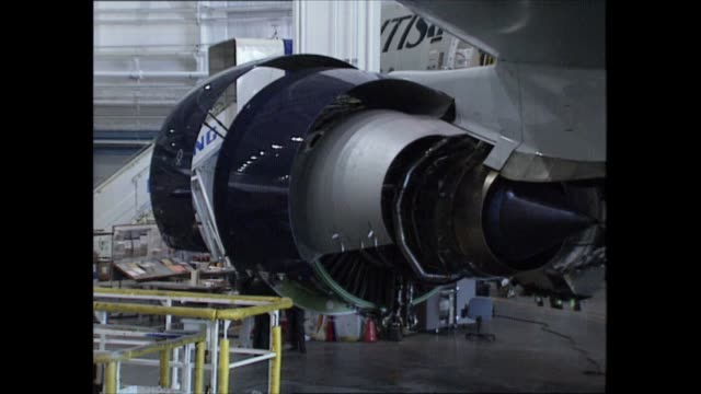stockvideo's en b-roll-footage met boeing 777 usa seattle int group of businessmen looking at new boeing 777 plane taking notes la boeing 777 and 'british airways' sign on side of... - new not politics