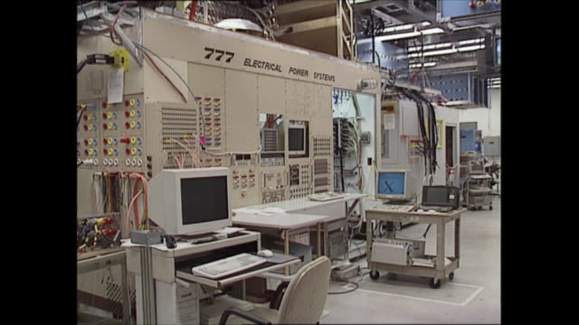 stockvideo's en b-roll-footage met boeing 777 usa seattle int tgv hangar floor wheels raised and lowered css wheels gv mockup of electrical power systems for boeing 777 sign '777... - new not politics