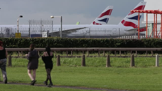 british airways parked at heathrow airport ahead of iag results, in london, u.k., on tuesday, july 27, 2021. international consolidated airlines... - incidental people stock videos & royalty-free footage