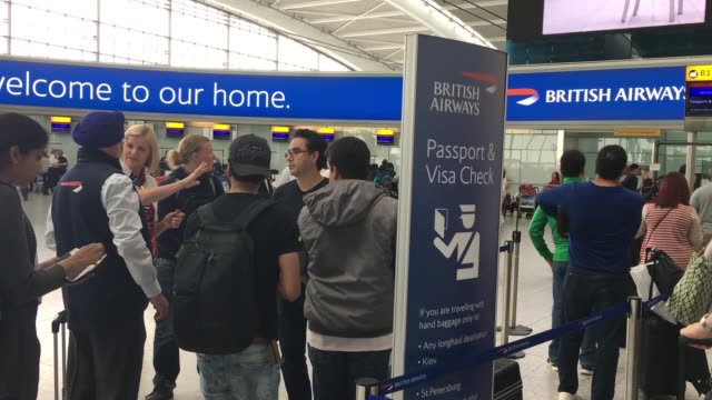 british airways passengers wait at heathrow airport after a worldwide it failure caused the airline to cancel most of its services in london, england... - passenger stock videos & royalty-free footage