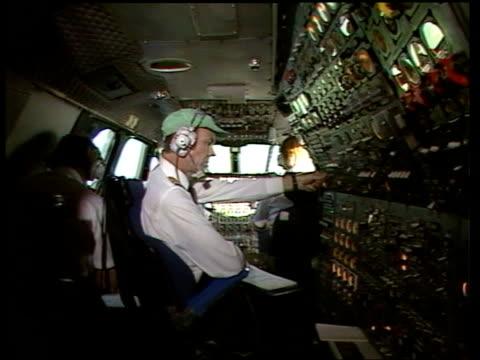 british airways supershuttle; itn london to glasgow subsonic flight: int sv concorde cockpit steward serves breakfast tray tms vicar at breakfast - cockpit stock-videos und b-roll-filmmaterial