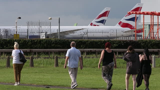 british airways terminal and planes at heathrow airport ahead of iag results, in london, u.k., on tuesday, july 27, 2021. international consolidated... - incidental people stock videos & royalty-free footage