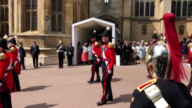stockvideo's en b-roll-footage met british and european royal women have turned on the style for garter day as foreign monarchs were honoured by the queen during a display of pomp and... - koningin koninklijk persoon