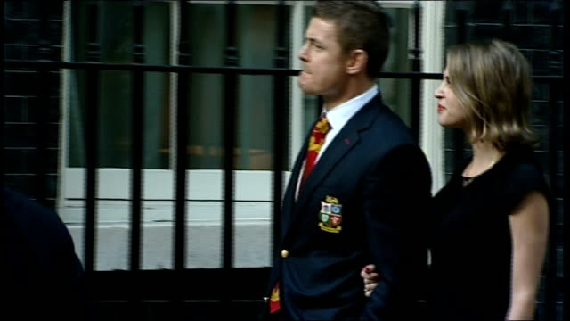 british and irish lions arriving for reception at no10 downing street british lions among which owen farrell walking along and into no10 / brad... - crutch stock videos & royalty-free footage