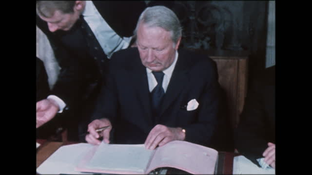 british and irish politicians including british prime minister edward heath and irish taoiseach liam cosgrave sign the sunningdale agreement in... - sign stock videos & royalty-free footage