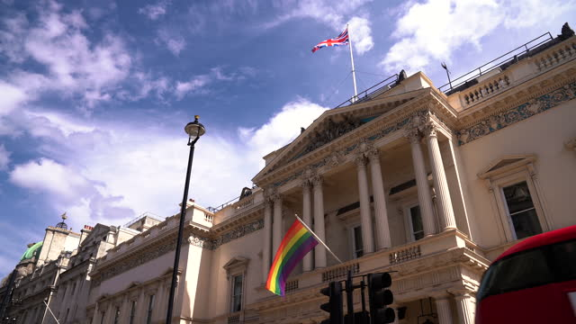 british and rainbow flags hanged on historical building in london - genderblend stock videos & royalty-free footage