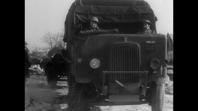 stockvideo's en b-roll-footage met montage british army deploying to france aboard train, trucks, tanks, and ship, a motorcycle messenger tooling along and stopping at military checkpoint to show papers, and munitions workers using handcart to move shells in factory / united kingdom - geallieerde mogendheden