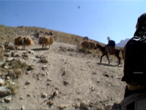 british army patrol on horseback in mountains of the samangan province; mountain valley and british troops on horseback patrol in fairly green... - hay stock videos & royalty-free footage
