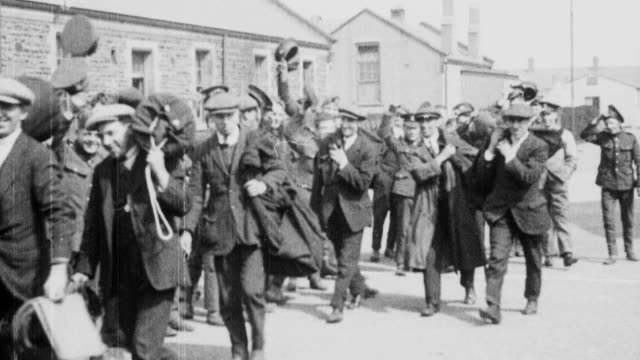 1921 MONTAGE British Army regulars welcoming the London Scottish reservists as they arrive at barracks / London, England