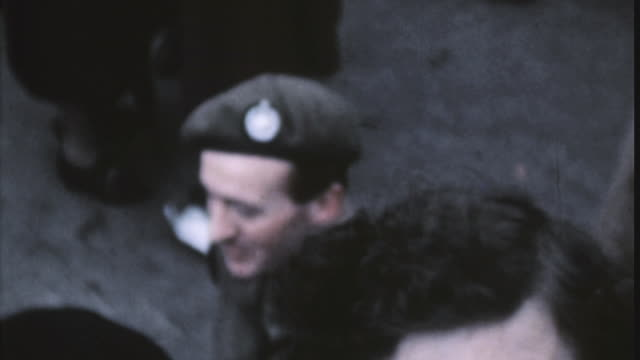 british army soldier david niven talking to a woman and signing an autograph in a crowd on ve day / london england united kingdom - ve day stock-videos und b-roll-filmmaterial