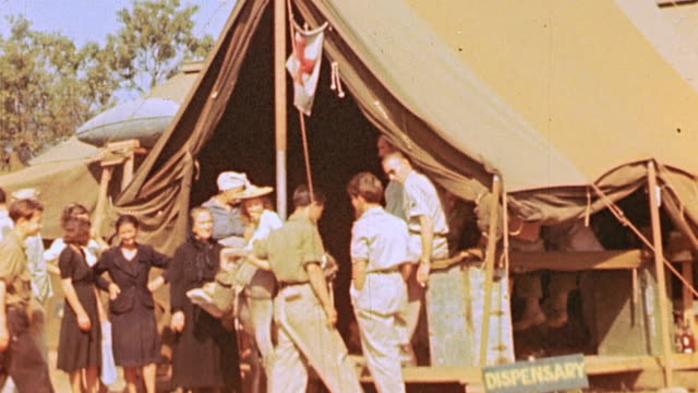 british army soldiers carrying casualty on stretcher and soldiers and french resistance fighters gathered outside first aid tent / marseilles france - french army stock videos & royalty-free footage