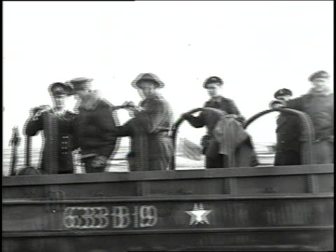 british army soldiers driving amphibious landing craft ashore and saluting camera as field marshal montgomery arrives in normandy / france - landing craft stock videos & royalty-free footage