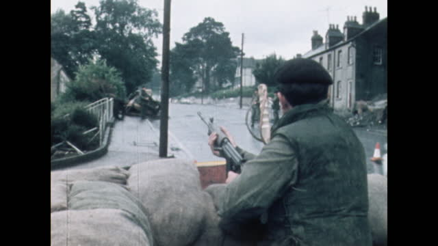british army soldiers guard a checkpoint close to the irish border in newry, northern ireland; 1971. - examining stock videos & royalty-free footage