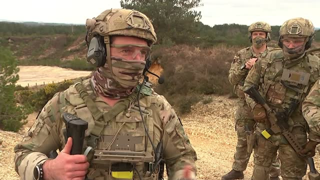 british army to be cut with increased use of use of drones and technology; england: dorset: bovington camp: ext royal marines commando holding weapon... - digital tablet stock videos & royalty-free footage