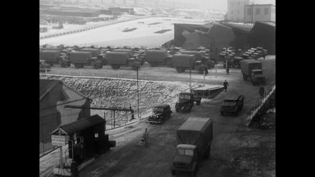montage british army trucks and cruiser tanks driving from the factory, and tanks being skid tested on snow / united kingdom - storage tank stock videos and b-roll footage