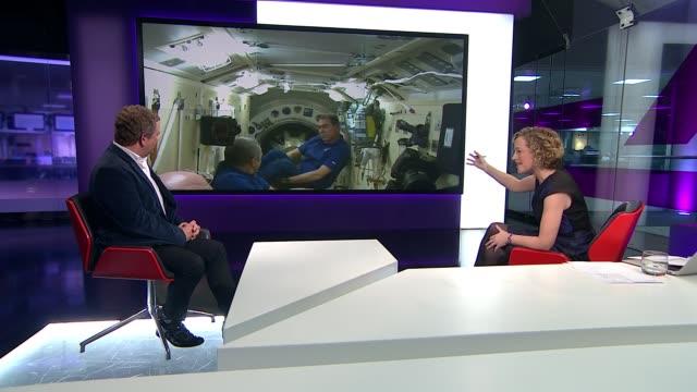 british astronaut tim peake joins crew on space station england london gir jon culshaw live studio interview sot [in front of plasma screen of... - キャシー・ニューマン点の映像素材/bロール