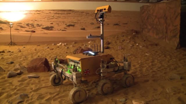 british astronaut tim peake successfully operates the exomars rover from the international space station controlling the six wheeled machine in a... - stevenage stock videos and b-roll footage