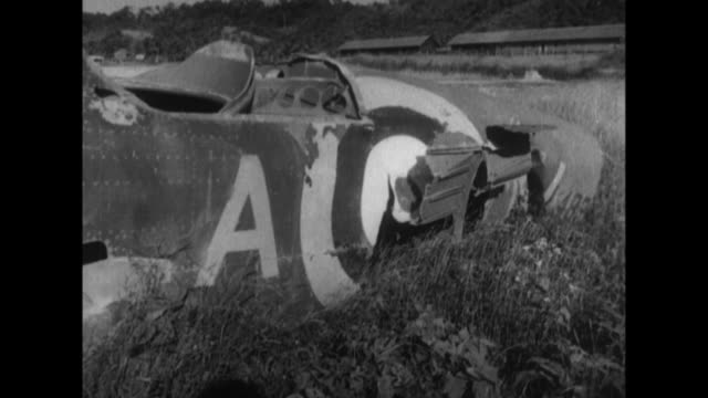a british attack on victoria air base in burma during world war ii causes damage to storage drums airplanes cars and a radio transmission station - myanmar stock videos & royalty-free footage