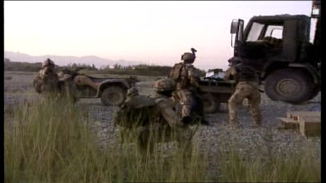 officer's comments tx afghanistan helmand province ext british soldiers under attack from taliban amberbush sot apache helicopter flying along... - sandbag stock videos & royalty-free footage