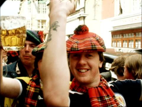 scotland fans arrive in london for england match england london ext shots of scotland supporters/fans with drinks singing outside pub downing street... - margaret thatcher stock videos & royalty-free footage