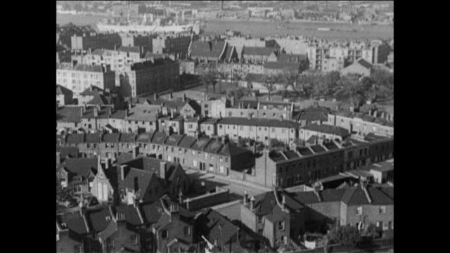 panning british city fills the landscape / uk - terraced house stock videos & royalty-free footage