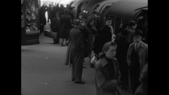 vídeos y material grabado en eventos de stock de montage british civilians living in the suburbs rushing to catch a train to london / london, england, united kingdom - 1930 1939