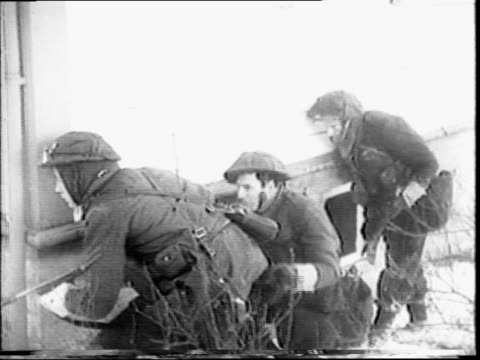 british commando's preparing to storm nazi troops / royal navy ship at sea / two men on deck of ship looking out / close up of soldiers pinning hand... - special forces stock videos & royalty-free footage