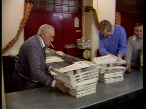 british communists; england: london: cms morning star newspapers off press printers stand reading newspapers as papers off press papers onto table as... - paper stock videos & royalty-free footage