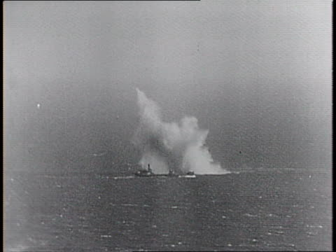 british convoy of ships at sea / paramount cameraman jf gemmell with camera behind sandbags / montage of nazi bombers in sky, dropping bombs on... - newsreel stock videos & royalty-free footage