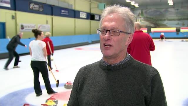 Lockerbie INT Various of people 'playing' curling on ice rink/ Alistair Stevenson interview SOT/ Katie Stevenson interview SOT