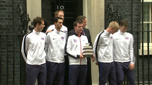 British Davis Cup winning team welcomed to Downing Street Shows exterior shots Great Britain Davis Cup winners walking out of 10 Downing Street with...