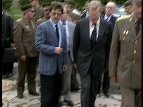 12 *CR1127 HUNGARY BRITISH 0230 Gv's of British Defence Secretary Tom King MP being greeted by Hungarian Military Officials before entering building...