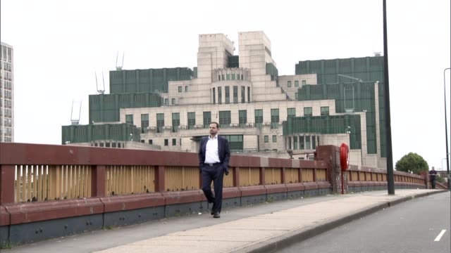 british double agent on life inside alqaeda england london ext aimen dean walking across vauxhall bridge and looking out over river thames with mi6... - al qaida stock videos & royalty-free footage
