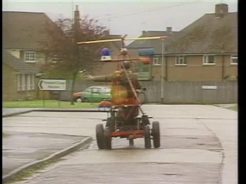 british eccentric, john ward, rides in a contraption made of junkyard scraps. - propeller stock videos & royalty-free footage