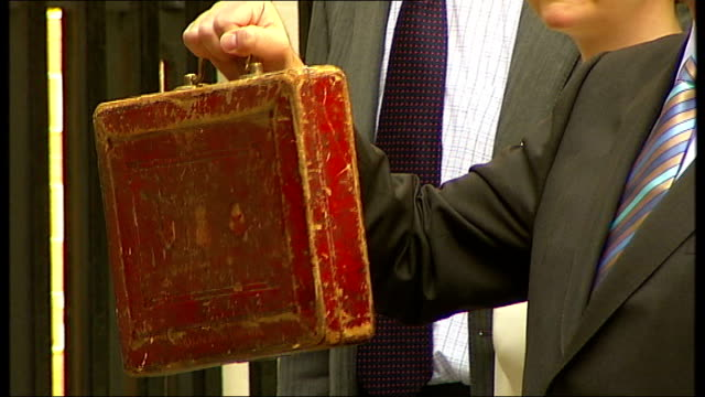 british economy falls further into recession tx london downing street ext alistair darling posing with budget box - recession stock videos & royalty-free footage