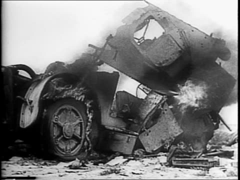 british eight army pushing across libya toward tripoli / gun firing, explosion / abandoned italian and german planes in at fuka airdrome / wreckage,... - armoured vehicle stock videos & royalty-free footage