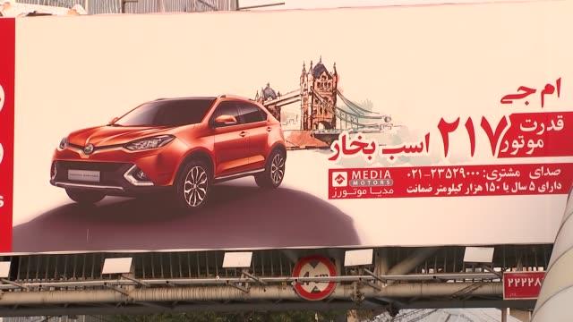 British Embassy in Iran Tehran street scenes EXT Tehran streets and pedestrians / Traffic / British cars advertised on billboards / Women shopping
