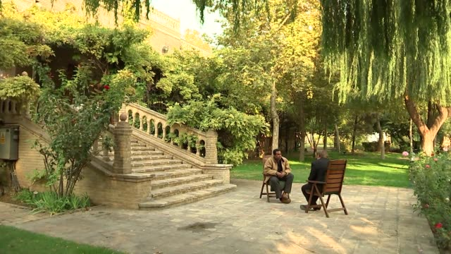 british embassy in iran tehran street scenes rageh omaar in british embassy garden with ben fender / various shots of garden and embassy exteriors - teheran stock videos & royalty-free footage