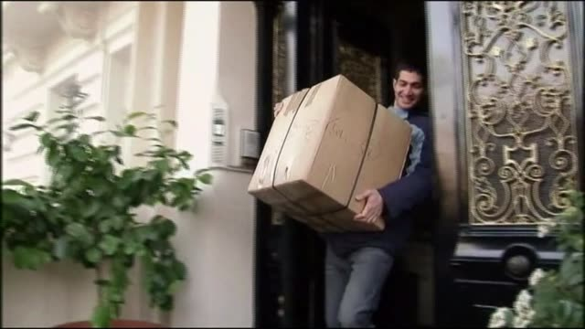 british embassy in tehran reopens / iranian embassy in london reopens t02121116 / tx ext man carrying box out of iranian embassy end lib - tehran stock videos & royalty-free footage