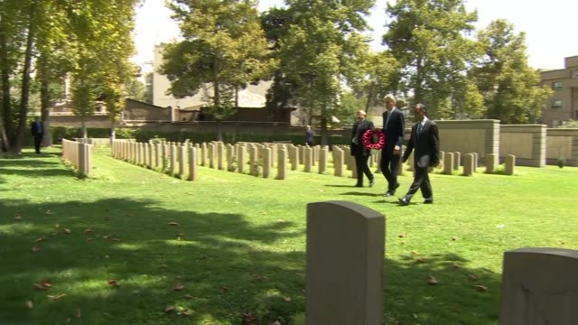 british embassy reopens / philip hammond visits war cemetery iran tehran tehran war cemetary ext gvs philip hammond mp arriving into cemetary /... - tehran stock videos & royalty-free footage