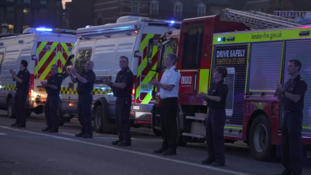 british emergency services are seen applauding nhs staff on westminster bridge on april 09 2020 in london england following the success of the clap... - nhs stock videos & royalty-free footage