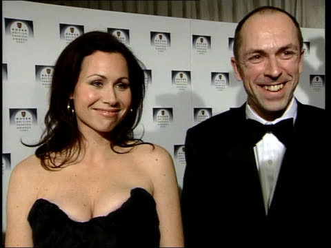 london rover british fashion awards photography** stella mccartney posing and along / designers posing for photocall holding award / joely richardson... - minnie driver stock videos and b-roll footage